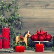 Christmas decorations with red candles and vintage toys — Stock Photo #50326587