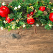 Christmas decoration red green gold over wooden background — Stock Photo #50327481