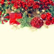 Christmas decoration with baubles, golden garlands and red berri — Stock Photo #50327629