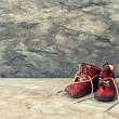 Vintage red baby shoes. retro style toned picture — Stock Photo #50327675