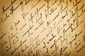 Old letter with vintage handwriting. Grungy paper background — Stock Photo