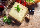 Cheese with red wine, walnuts and grapes. food background — Stock Photo
