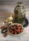 Dates, arabic lantern and rosary. Oriental decoration — Stock Photo