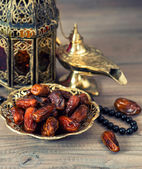 Traditional arabic lamp, latern, dates and rosary — Stock Photo