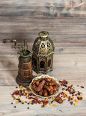 Still life with vintage orintal latern and mill. Raisins and dat — Foto de Stock