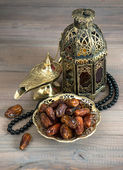 Dates, arabic lamps and rosary — Stock Photo