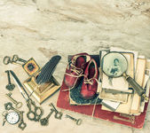Antique books and photos, keys and writing accessories — Stock Photo