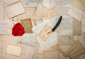 Old letters, handwritings, vintage postcards and red rose — Stock Photo