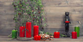 Christmas decoration with red candles, birdcage and pine branche — Stock Photo