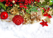 Christmas decoration with baubles, golden and red garlands — Stock Photo