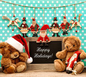 Christmas decoration with antique toys and blackboard — Stock Photo