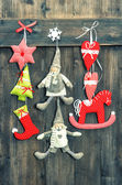 Christmas decoration handmade toys on wooden background — Stock Photo