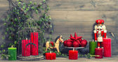 Christmas decorations with red candles and vintage toys — Stock Photo