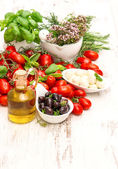 Fresh basil, tomatoes, mozzarella and olive oil. food background — Stock Photo