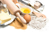 Baking ingredients eggs, flour, sugar, butter, yeast — Stock Photo