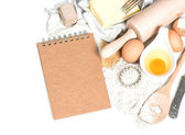 Baking ingredients eggs, flour, sugar, butter, yeast and recipe  — Stock Photo
