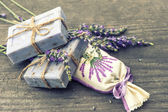 Lavender soap and scented sachets with fresh flowers — Stock Photo