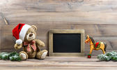 Christmas decoration with antique toys teddy bear and rocking ho — Stock Photo