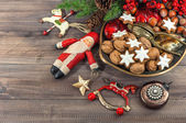 Christmas cookies and walnuts with vintage decorations — Stock Photo