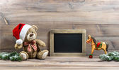 Christmas decoration with antique toys teddy bear and rocking ho — Foto de Stock