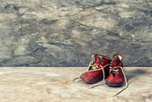 Vintage red baby shoes. retro style toned picture — Stock Photo