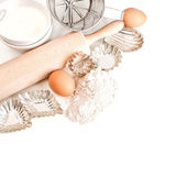 Flour, eggs, sugar, rolling pin. baking tools and ingredients — Stock Photo