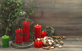 Vintage christmas decoration with candles and cookies — Stock Photo