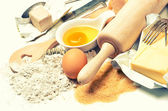 Baking ingredients eggs, flour, sugar, butter, yeast — Stockfoto