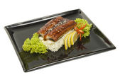 Baked eel cooked with rice and salad dining — Stock Photo