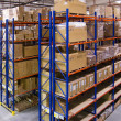 Warehouse with shelves and boxes — Stock Photo #30540125
