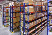Warehouse with shelves and boxes — Stock Photo