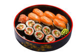 Nigiri sushi set in black round wooden plate — Foto de Stock