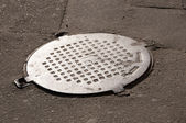 City manhole cover — Stock Photo