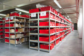 Storage room with boxes and shelves — Stock Photo