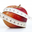 Red apple and centimeter — Stock Photo