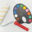 Roller for painting and palette with watercolor paints — Stock Photo