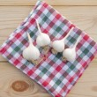Garlic on a wooden table. — Stock Photo #32267499