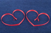 Two paper hearts on jeans background. — Stock Photo