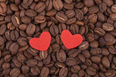 Two hearts on coffee beans. — Foto de Stock