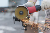 Sparks flying metal cutting abrasive disk. — Stock Photo