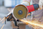 Sparks flying metal cutting abrasive disk. — Foto Stock