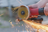 Worker cuts metal. — Stock Photo