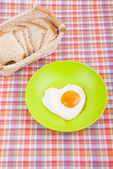 Scrambled in a heart shape on a plate. — Stock Photo