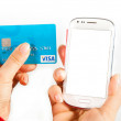 Smartphone credit card transaction — Stock Photo