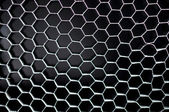Black hexagonal mesh honeycomb grid background — Stock Photo