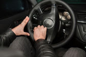 Hands sewing leather steering wheel — Stock Photo