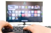 Smart tv and keyboard connect to the internet — Stock Photo