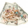 Royalty-Free Stock Photo: Gold jewelry and dollars