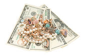 Gold jewelry and dollars — Stock Photo
