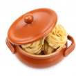 Spaghetti in a clay pot - Stock Photo